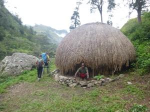 Dani Man in Traditional Hut